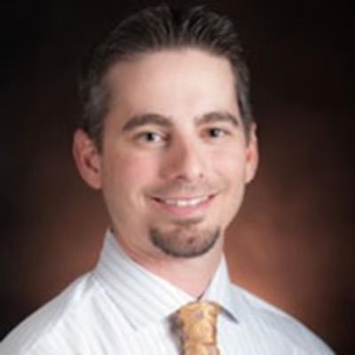 Dr. Russell Baker