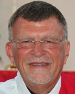 Dr. Regis Turocy
