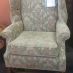 Upolstered olive green, floral print armchair