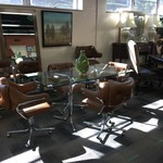 1-33067 Glass and Chrome Table w/ 4 Brown, Vinyl, Cushioned Chairs on wheels, Mid Century Modern