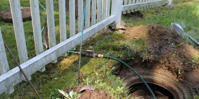 Introduce 150 gallons of environmentally friendly dyed water into the septic system