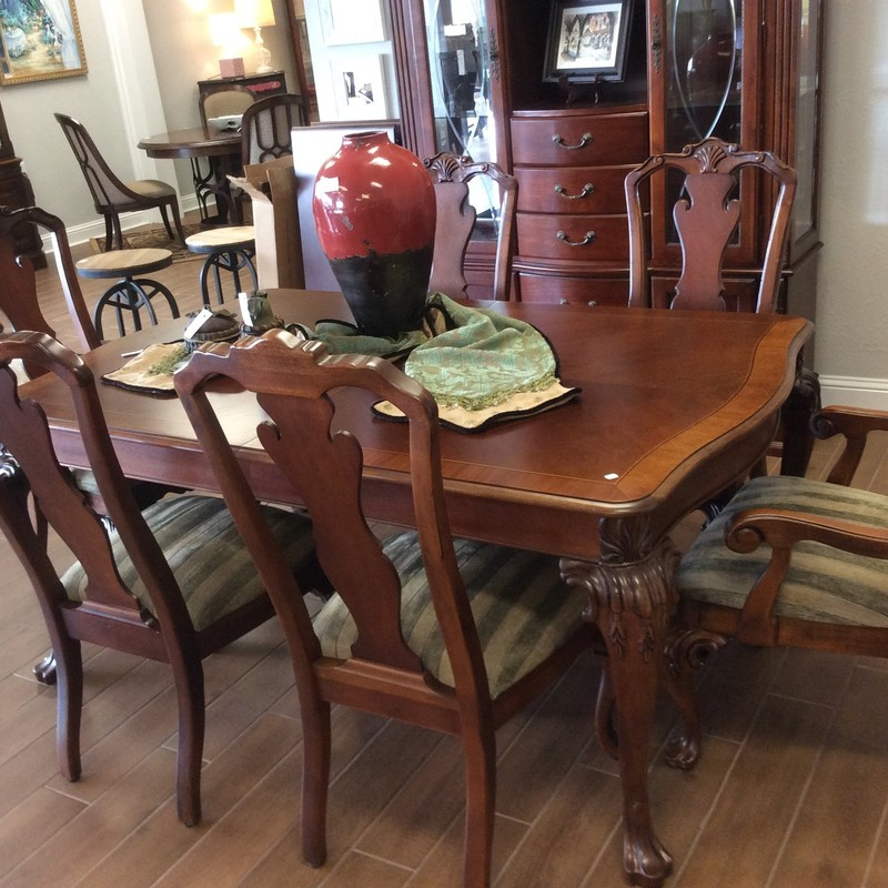 This is a lovely THOMASVILLE dining room set. It features solid 2-tone wood construction with pretty carved details on the table legs and chairs. The 2 leaves are 20 each, so with them inserted, the table is over 9 feet long. The neutral gray/green upholstery on the chairs should go with most any decor, too!