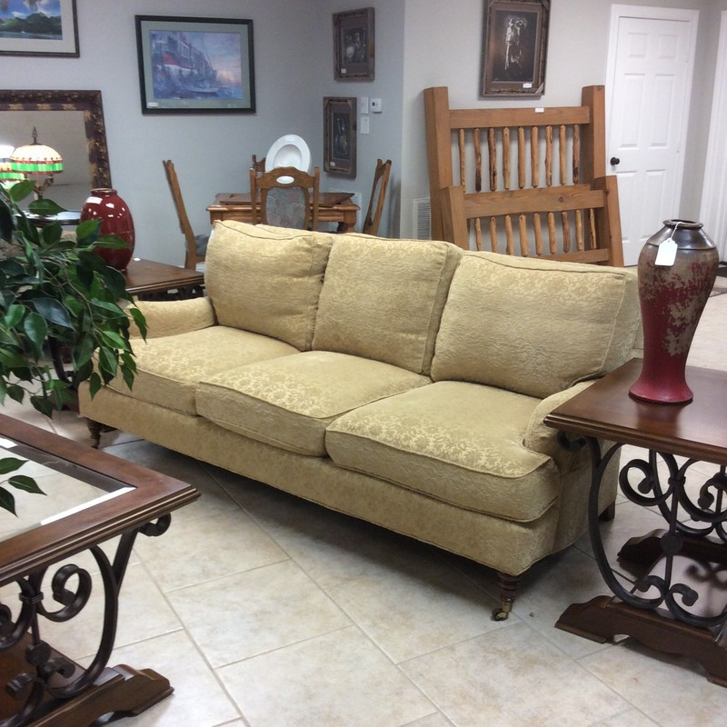 This is a very pretty down sofa in a soft, buttercream chenille.  It's rather unusual in that the two front legs are on tiny casters. Very good condition too. Come take a look soon!