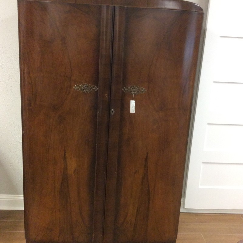 """This vintage piece is in very good condition, for it's age. It is solid wood with pretty veneer outer surfaces. The inside has LOTS of room for hanging items, as well as a shelf for """"Hats"""". It's only $195, so stop by and see it for yourself!"""