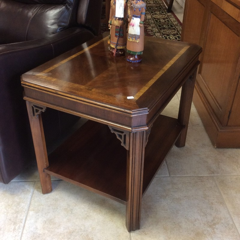 """This little """"vintage"""" table is a LANE. It features solid 2-toned cherry wood construction, a lower shelf and pretty carved accents at the top of each leg. Hurry in, though, as it's priced at only $145!"""