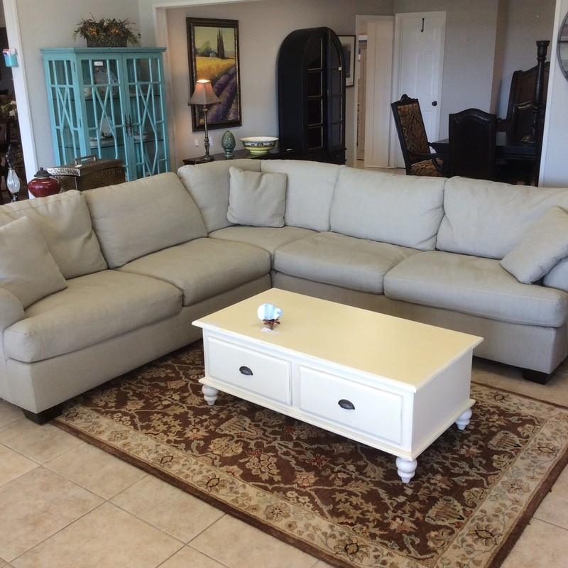 This 3-piece HAVERTY sectional is lovely. It features a cozy grayish-green, linen-like upholstery and all of the pillows are removable for easy cleaning.