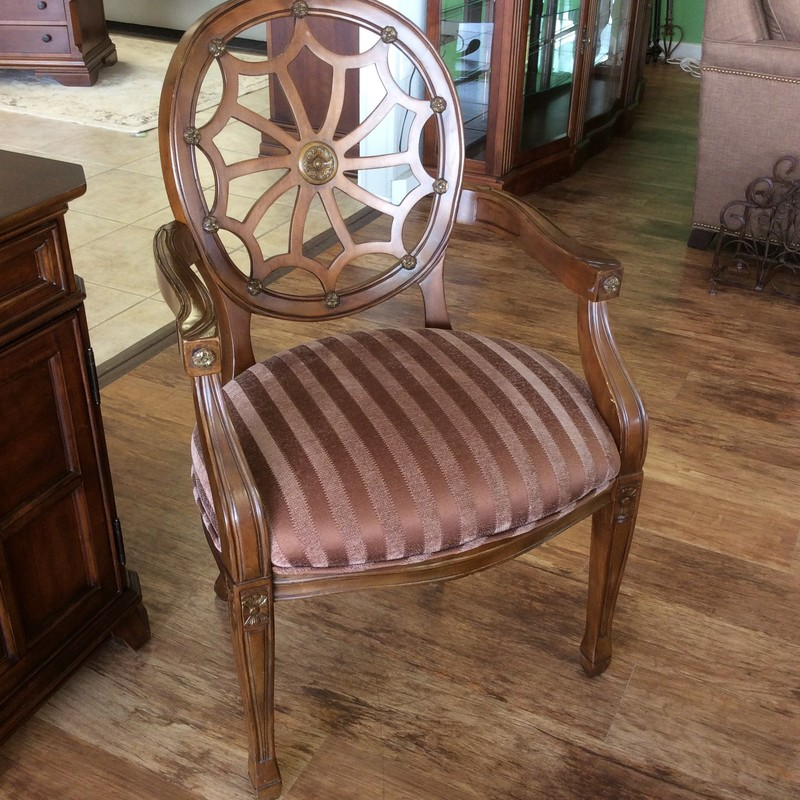 This arm chair is really pretty! It features detailed woodworking and a chocolate/mocha striped upholstery on the seat. Great condition!