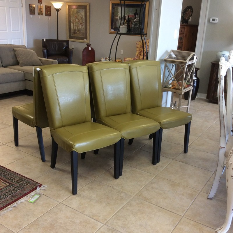 This set of 6 is contemporary in design upholstered in an olive green. Good condition and priced well!