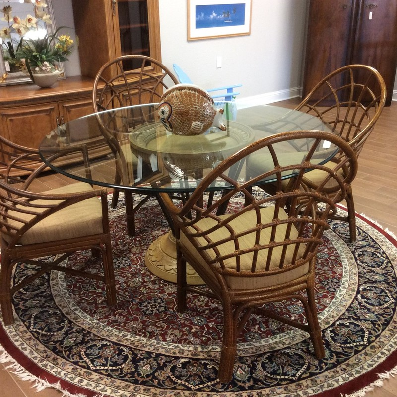 """This is a really beautiful dining set! The 60"""" round glass topper is 3/4"""" thick and sits upon a HEAVY iron and composite base. The best part of this set, though, is the chairs. They are fabulous!"""