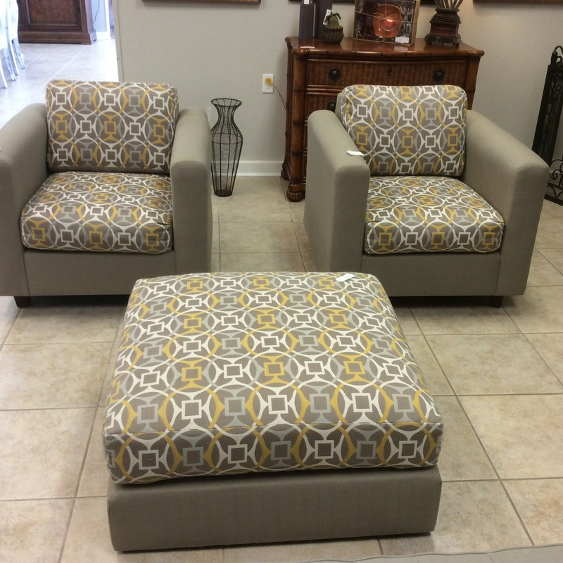 """This """"WOW"""" pair actually goes back to 1965 and they are in great condition! Mid-Century in design, they are bold statements of the period. The set has recently been reupholstered in a peaceful gray with  a splash of yellow and white. The ottoman matches, is oversized and best of all, is on casters."""