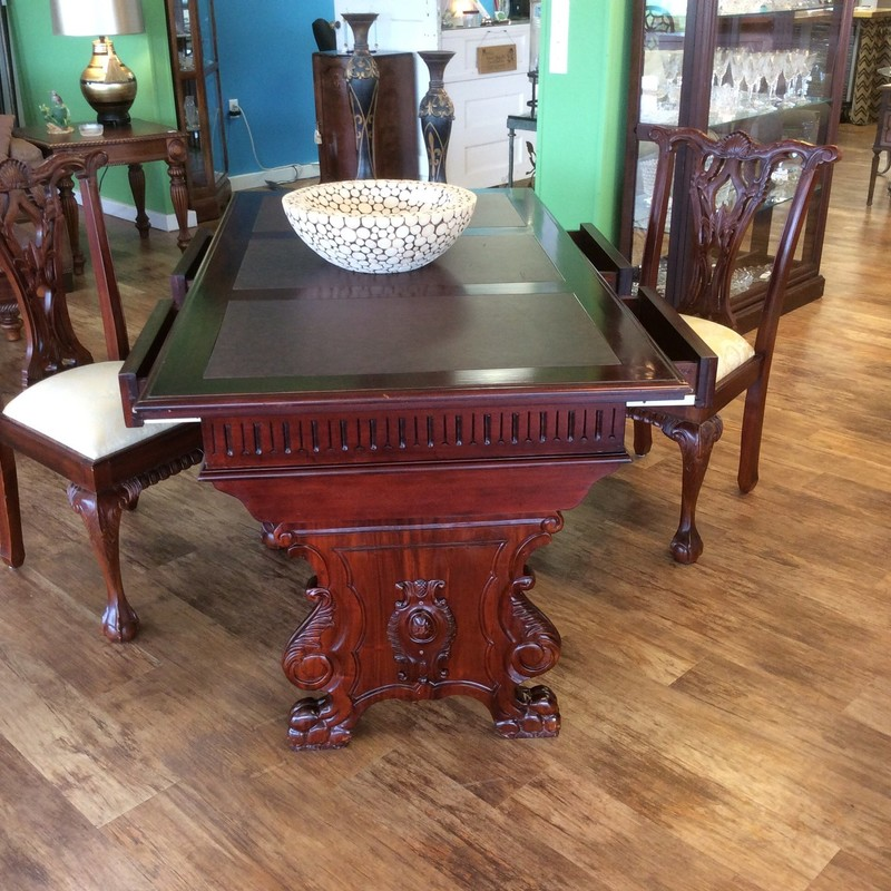 This set appears to be constructed entirely of wood and has a dark cherry finish. There are 4 drawers and 3 leather inlays on the top of the desk, and both the bottom of the desk, as well as the 2 chairs feature intricate, ornate carved details. AND it's only $595 for all 3 pieces!!