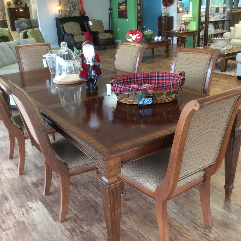 """This elegant ETHAN ALLEN dining room set is in remarkable condition. When the two (22"""" each) leaves are inserted, the table measures almost 10 feet long! The sleigh-backed chairs are quite comfortable and feature a neutral camel/brick upholstery."""