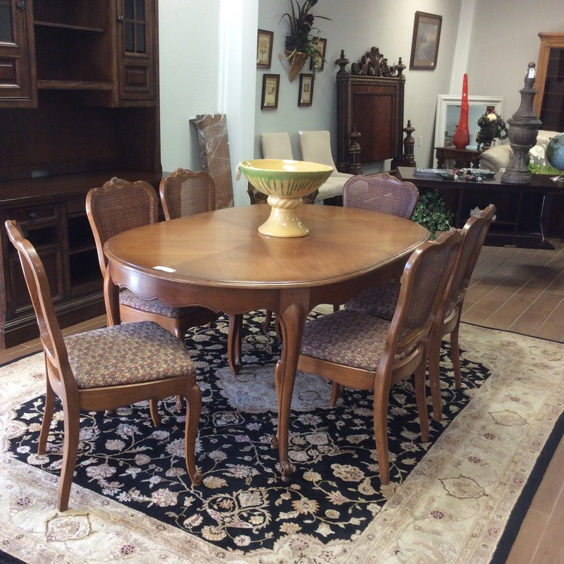 This is a sweet dining room set by Drexel! So, although it's seen some love (wear) it's a well made set. The table has 3 leaves so it's the the perfect table for either a small gathering or a large one. It includes 6 upholstered chairs with a cane back. Priced well!
