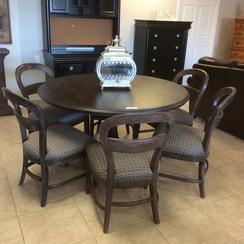 This dining room set by Stanley is lovely! The table is expresso colored flanked by 6 comfy chairs which have been upholstered in a gray & taupe geometric pattern. This would be a beautiful set for your next holiday gathering! Come visit us soon!