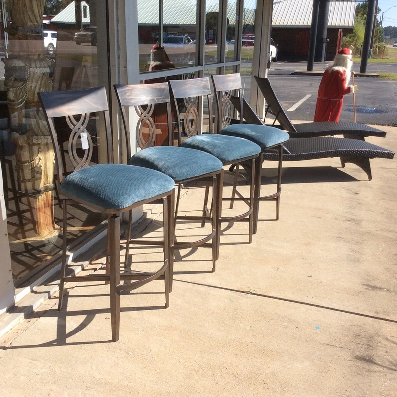 This set of 4 barstools is by Minson. They are solid and sturdy with an upholstered seat in a pretty blue. They also swivel. Come take a look!