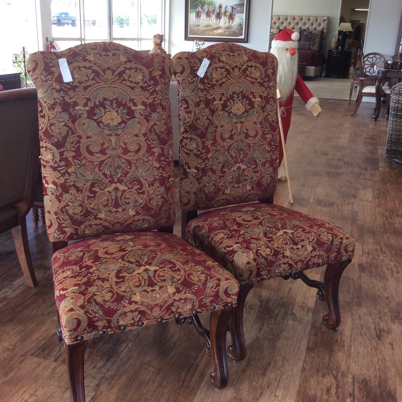 This is a lovely pair of dining room chairs. Upholstered in red, gold and green with a nailhead trim. Best of all, we have a second identical pair!