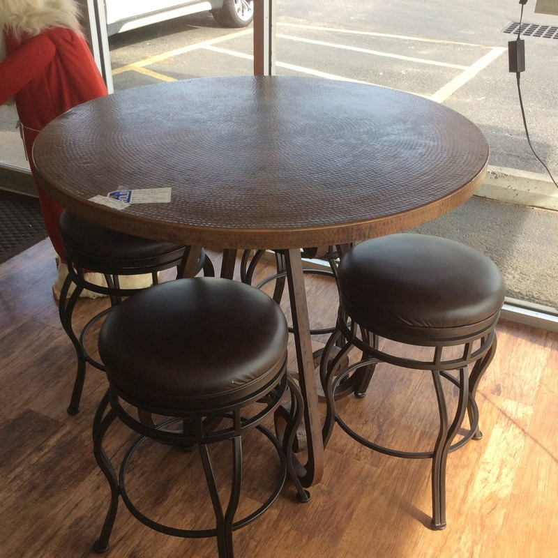 """This is a great little set. The hammered copper top sits on a heavy scrolled iron base. The stools SWIVEL and have leather upholstered seats with scrolled iron bases. The table is 35"""" tall, and the barstools are 25"""" high. Great set for only $895!"""