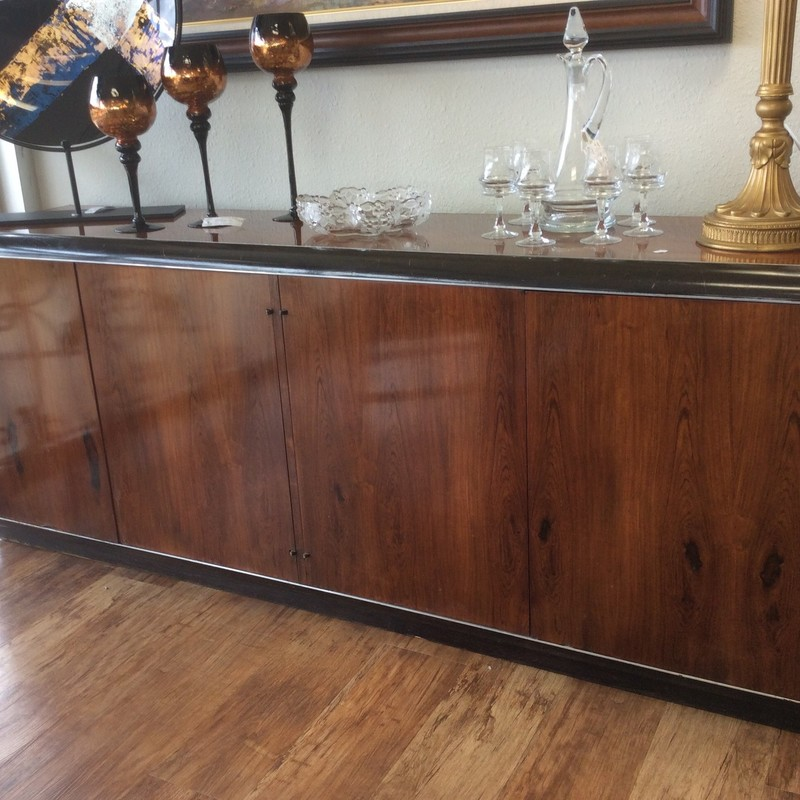 This credenza by G. Carson is for discriminating tastes! It is mid-century which is a highly praised celebration of 50's design. This credenza has lots of storage space including shelves and 4 drawers. Come in and take a look!
