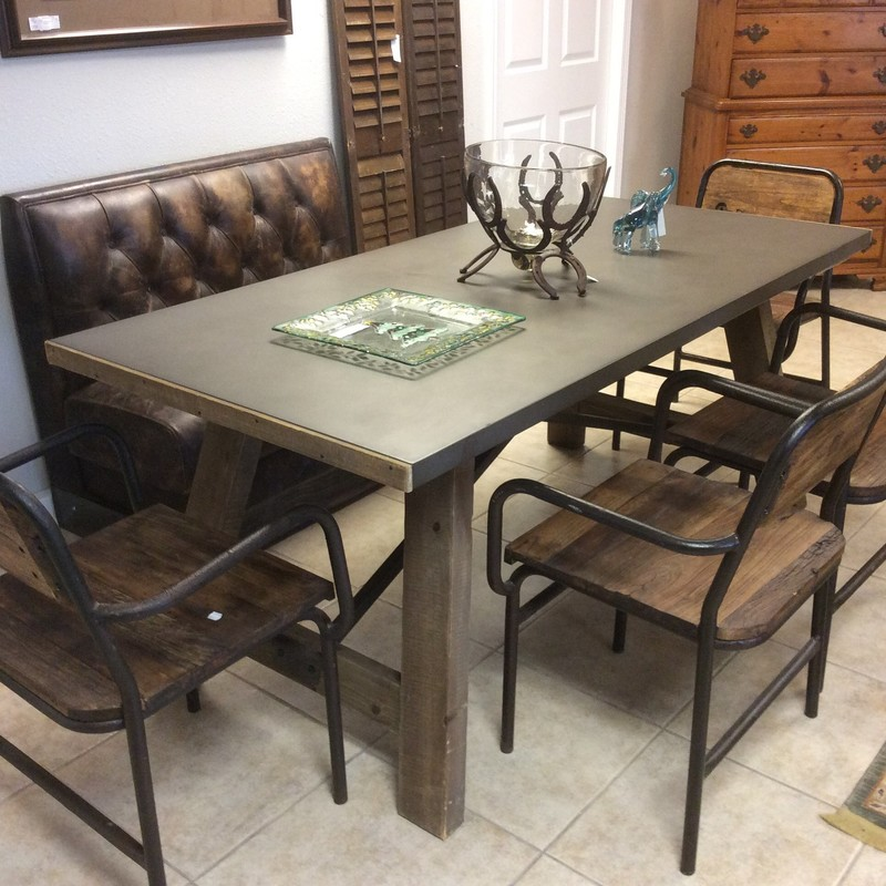 This is a really nice 6 piece dining set. The table has a wooden base and a ZINC top. The 4 chairs are rough-hewn wood with metal pipe frames. The banquette is upholstered in a distressed brown leather and has a tufted back. Great price at only $1195 of all of it!