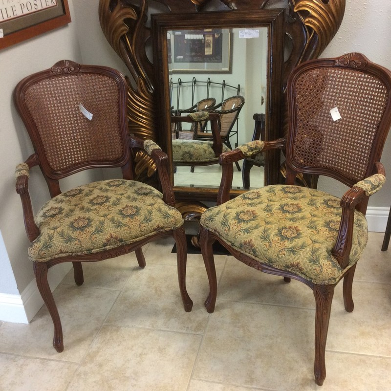 These cherry wood chairs are in fabulous condition. The both have carved wood frames, caned backs and upholstered seats and arms. They're comfy too. Stop by and check them out.