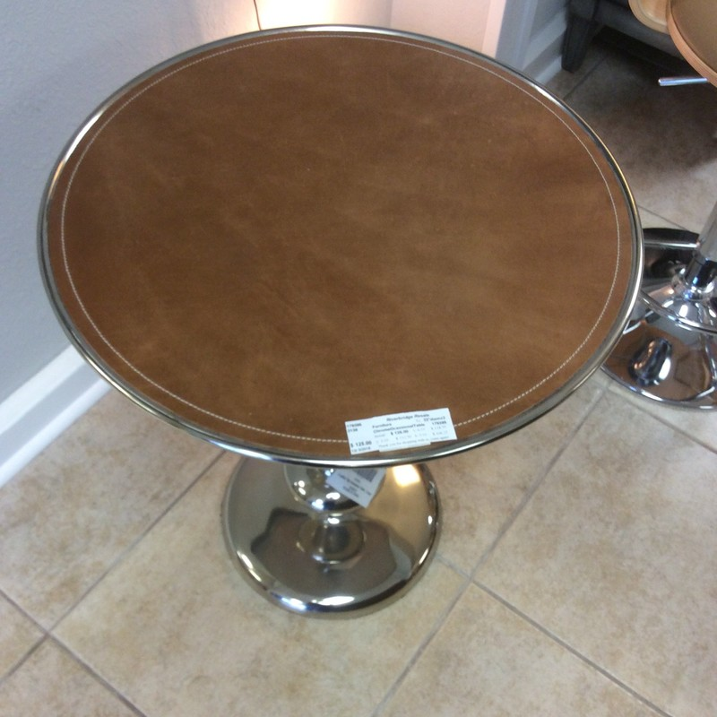 This cute little chrome table has a leather topper on it. It looks brand new and even still have tags hanging on it! At only $125, it won't be here long!