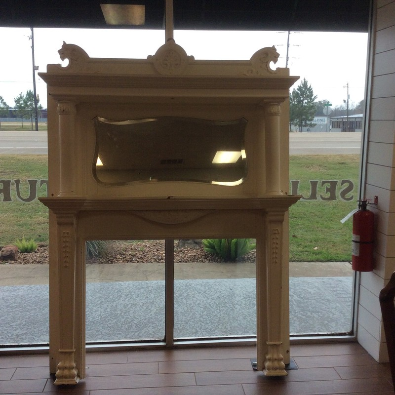 This massive ANTIQUE fireplace mantle needs a big wall, for sure. If you're building or remodeling maybe you have the perfect place to install this beauty. The mirror is beveled and all of the painted details are hand carved.