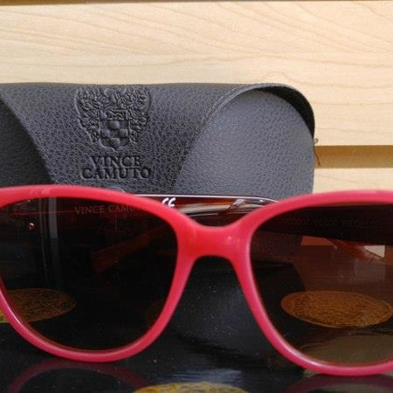 Vince Camuto Sunglasses.  A stunning pink color.  Grey case included.