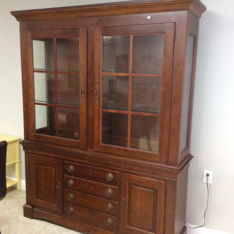 This solid wood BASSETT cabinet is in pristine condition. It is actually 2 pieces and features 4 drawers, glass shelves with plate grooves, 2 lower cabinets with 1 shelf in each, and textured glass. There is also a matching buffet, available for purhase separately