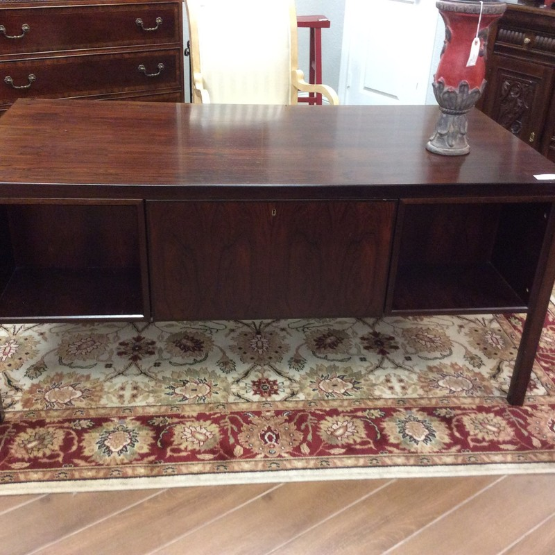 This elegant executive desk features solid walnut construction, and a rich dark cherry finish. There are 2 cubbies and a cabinet that face outward and there are 6 small drawers facing inward. GORGEOUS!