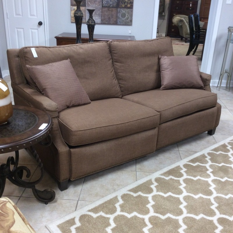This an awesome double reclining sofa! Made by Motioncraft, it's made in the U.S.A.. Upholstered in a mocha brown with attached  back pillows and nailheading, it's in pristeen condition.